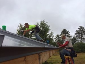 Dan Perkins Construction employees Seth Wixtrom,left, and Ben Kari install metal roof to the new bath house at AMVETS Post 122 in Ely Township on Tuesday. http://www.miningjournal.net/page/content.detail/id/603735.html