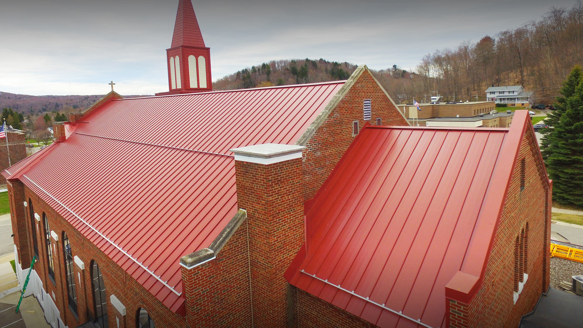 Red metal roof on a Catholic Church.